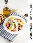fresh salad made of tomato ... | Shutterstock . vector #1044712138