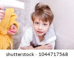 mothers drying her beautiful... | Shutterstock . vector #1044717568