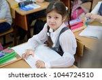 girl schoolgirl upset by a... | Shutterstock . vector #1044724510
