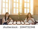 two teenage women meet in... | Shutterstock . vector #1044731548