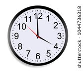 round clock face showing four o'... | Shutterstock .eps vector #1044736318
