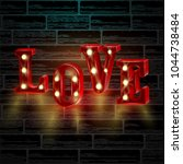 neon 3d word love with lights. | Shutterstock .eps vector #1044738484