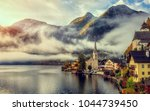 picturesque misty morning of... | Shutterstock . vector #1044739450