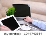 hand hold tablet on stylish... | Shutterstock . vector #1044743959