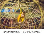 the boy passes the obstacle... | Shutterstock . vector #1044743983