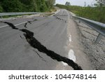 road collapses with huge cracks.... | Shutterstock . vector #1044748144