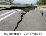 road collapses with huge cracks.... | Shutterstock . vector #1044748189