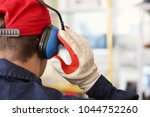 male worker with hearing... | Shutterstock . vector #1044752260