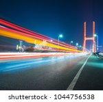traffic trails on bridge of... | Shutterstock . vector #1044756538