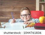 happy smiling boy in glasses at ...   Shutterstock . vector #1044761836
