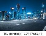empty road with city skyline... | Shutterstock . vector #1044766144