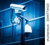 surveillance camera blue toned... | Shutterstock . vector #1044773410