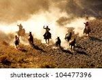 Cowboys Chasing Wilding Horses. ...