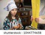 girl at cooking class | Shutterstock . vector #1044774658