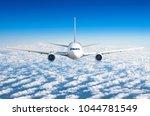 passenger airplane flying at... | Shutterstock . vector #1044781549