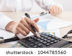 close up of female accountant... | Shutterstock . vector #1044785560