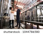 a male and a female technician... | Shutterstock . vector #1044786580