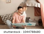 father with little daughter...   Shutterstock . vector #1044788680