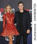 chris zylka and paris hilton at ... | Shutterstock . vector #1044808720