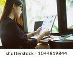 young businesswoman working... | Shutterstock . vector #1044819844