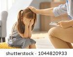 sad little girl at child... | Shutterstock . vector #1044820933
