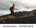 hiker walks on the slope of... | Shutterstock . vector #1044821818