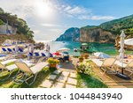 sunbeds and umbrella on the... | Shutterstock . vector #1044843940