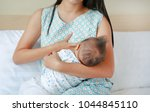 close up infant baby feeding...   Shutterstock . vector #1044845110
