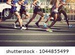 marathon runners legs running... | Shutterstock . vector #1044855499