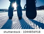 snowboarder with snowboard... | Shutterstock . vector #1044856918