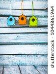 spring bird house on white wood.... | Shutterstock . vector #1044861964