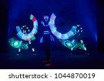 laser show performance  dancers ... | Shutterstock . vector #1044870019