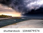 big storm front rolling in to... | Shutterstock . vector #1044879574
