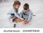 children play with a toy... | Shutterstock . vector #1044895840