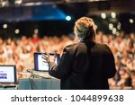 female speaker giving a talk on ... | Shutterstock . vector #1044899638