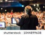 female speaker giving a talk on ... | Shutterstock . vector #1044899638
