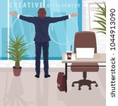 happy employee at workplace in... | Shutterstock .eps vector #1044913090