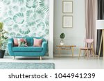 cozy turquoise couch  wooden... | Shutterstock . vector #1044941239