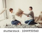 happy couple jokingly holds the ... | Shutterstock . vector #1044950560