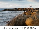 fisherman at the baltic sea | Shutterstock . vector #1044954346