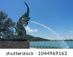 the naga statue is spraying... | Shutterstock . vector #1044969163