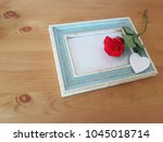 single rose laying on a vintage ... | Shutterstock . vector #1045018714