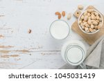 almond milk in glass and jar on ... | Shutterstock . vector #1045031419