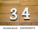 Small photo of Figure thirty-four on a wooden, parquet floor as a background.
