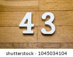 figure forty three on a wooden  ... | Shutterstock . vector #1045034104