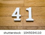 figure forty   one on a wooden  ... | Shutterstock . vector #1045034110
