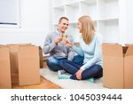 young couple is moving in their ... | Shutterstock . vector #1045039444