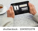 Small photo of Digital composite of Hands holding tablet with rate button and star ratings review