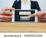 Small photo of Digital composite of Woman holding tablet with rate button and star review ratings