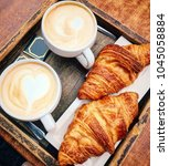 croissants and coffee. | Shutterstock . vector #1045058884